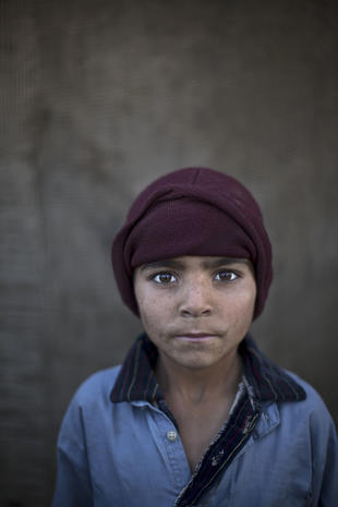 Faces of young Afghan refugees