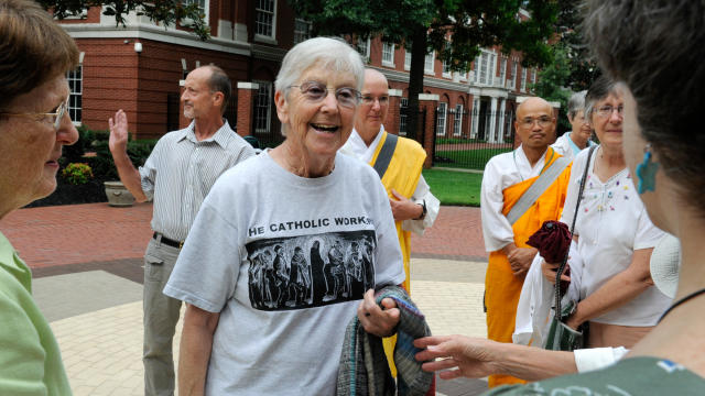 Sister Megan Rice, center, and Michael Walli, in the background waving, are greeted by supporters as they arrive for a federal court appearance in Knoxville, Tenn., Aug. 9, 2012.