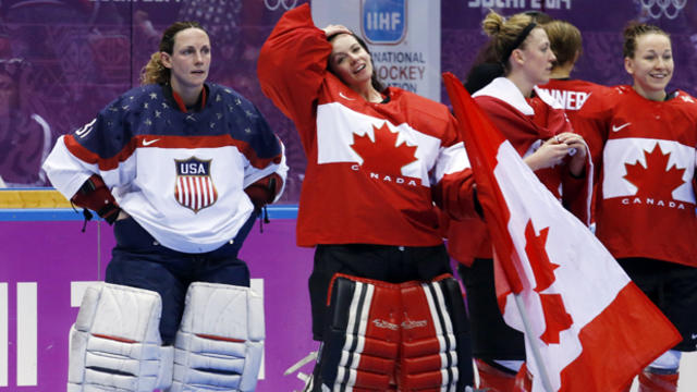 USA goalkeeper Jessie Vetter (31) and goalkeeper Shannon Szabados of Canada (1) await the start of the medal ceremony after Canada beat the USA 3-2 in overtime of the women's gold medal ice hockey game at the 2014 Winter Olympics Feb. 20, 2014, in Sochi,