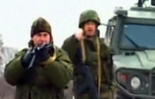 Russian troops fire warning shots in Ukraine