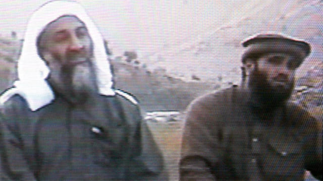 This frame grab from the Saudi-owned television network MBC (Middle East Broadcasting Center) shows Osama bin Laden, left, sitting next to Suleiman Abu Ghaith, the spokesman of his al Qaeda network, in an undated videotape broadcast by the Dubai-based MBC
