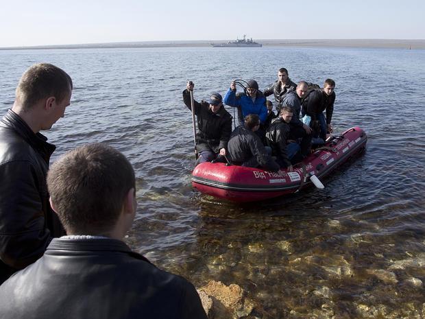 Ukrainian sailors leave the Konstantin Olshansky navy ship in the bay of Donuzlav, Crimea