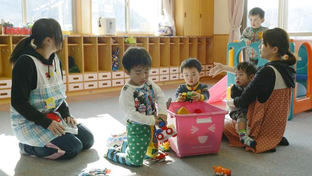 Toddlers play at a nursery school in Tamura, Fukushima Prefecture, northeastern Japan, April 1, 2014