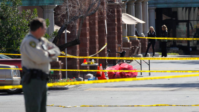 The FBI and the Pima County Sheriff's Department investigate the crime scene after Jared Loughner opened fire on a group of people Jan. 9, 2011, in Tucson, Ariz.