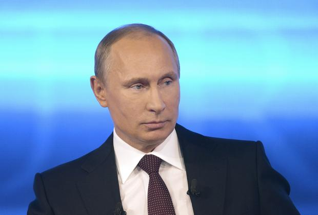 Russian President Vladimir Putin takes part in a live nationwide phone-in broadcast