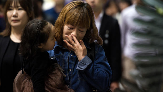 People attend a memorial for the victims of the sunken South Korean ferry Sewol at the Ansan Olympic memorial hall April 26, 2014.