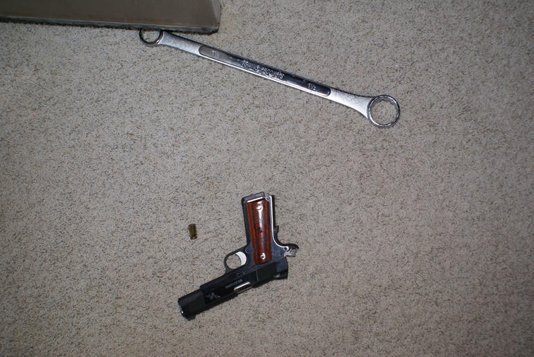 Wrench and gun found at the crime scene