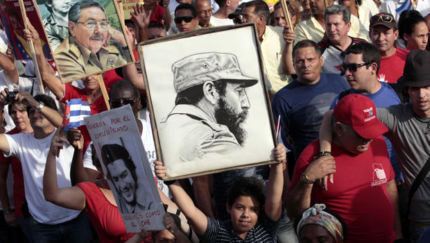 A child holds a poster of Cuba's former president, Fidel Castro, during a May Day parade in Havana May 1, 2014.
