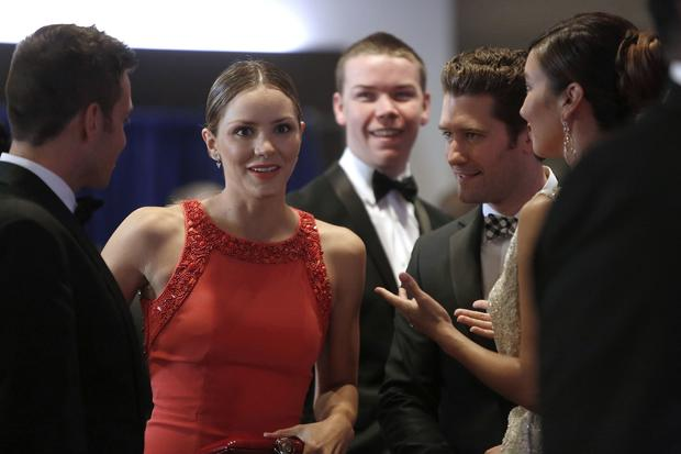 Singer and actress Katharine McPhee talks with actor Matthew Morrison, second right, as they arrive on the red carpet at the annual White House Correspondents' Association dinner in Washington May 3, 2014.