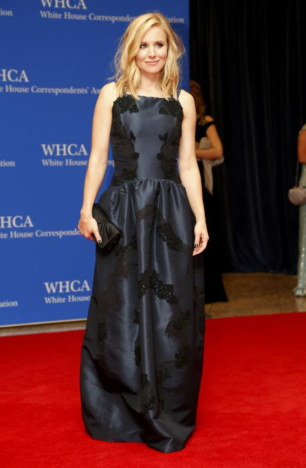 Actress Kristen Bell arrives on the red carpet at the annual White House Correspondents' Association dinner in Washington May 3, 2014.