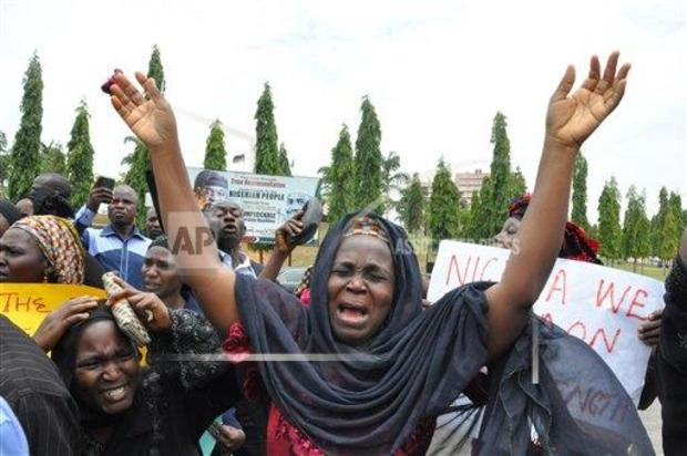 An unidentified mother cries out during a demonstration with others who have daughters among the kidnapped school girls of government secondary school Chibok