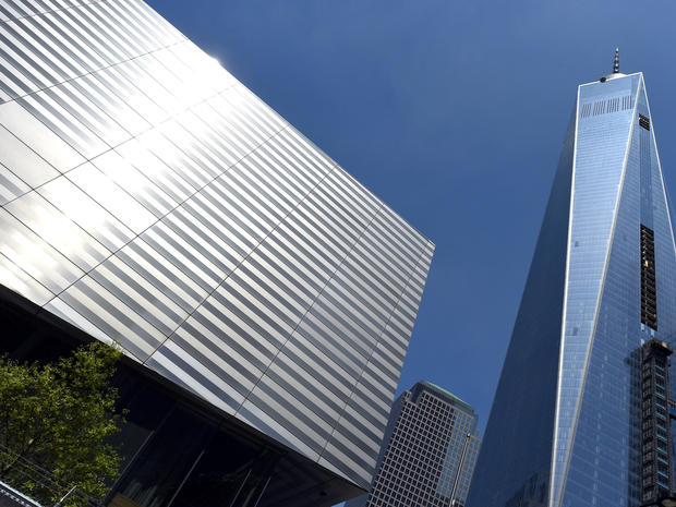 The National September 11 Memorial & Museum is seen next to One World Trade Center during a media tour May 13, 2014.