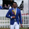 USA swimmer Michael Phelps walks through infield before the 139th Preakness Stakes at Pimlico Race Course in Baltimore May 17, 2014.