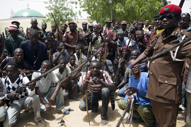A vigilante group of traditional hunters poses for a picture at its camp in Maiduguri, Nigeria, May 21, 2014.