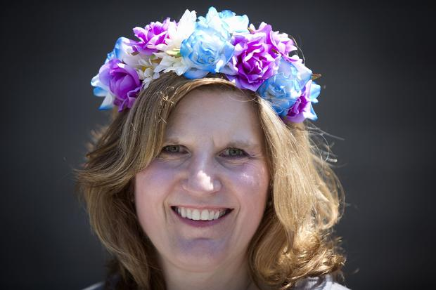 Alisa Glenn poses for a portrait with her colorful hat before the 146th running of the 2014 Belmont Stakes in Elmont, New York, June 7, 2014.
