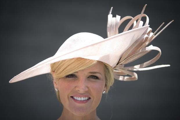Carolyn Manno poses for a portrait with her hat before the 146th running of the 2014 Belmont Stakes in Elmont, New York, June 7, 2014.