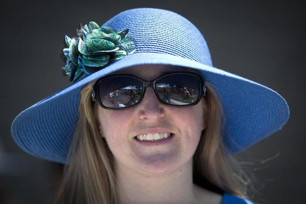 Julia Logan poses for a portrait with her colorful hat before the 146th running of the 2014 Belmont Stakes in Elmont, New York, June 7, 2014.