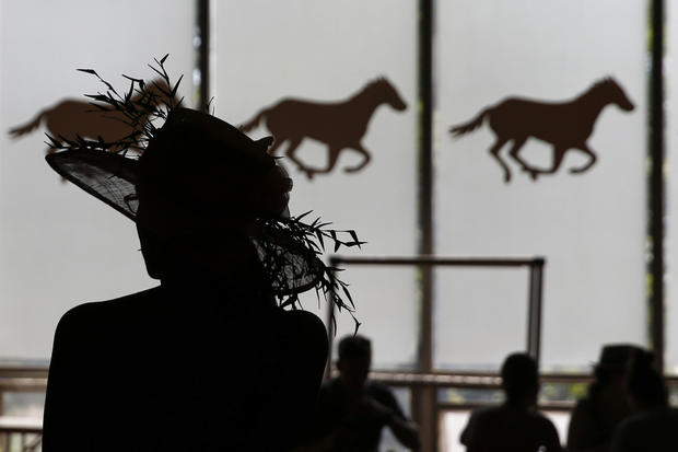 A woman is seen in silhouette at Belmont Park before the 2014 Belmont Stakes in Elmont, New York, June 7, 2014.