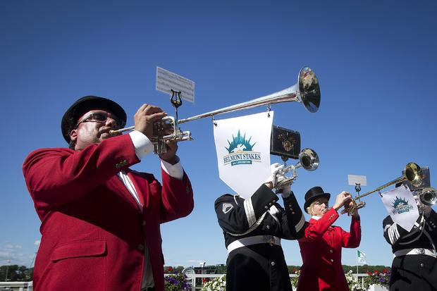 """Buglers play the """"Call to Post"""" before the 146th running of the 2014 Belmont Stakes in Elmont, New York, June 7, 2014."""