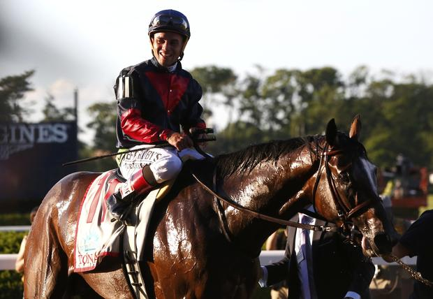 Jockey Joel Rosario, in the irons on Tonalist, smiles after winning the 146th running of the Belmont Stakes at Belmont Park in Elmont, New York, June 7, 2014.