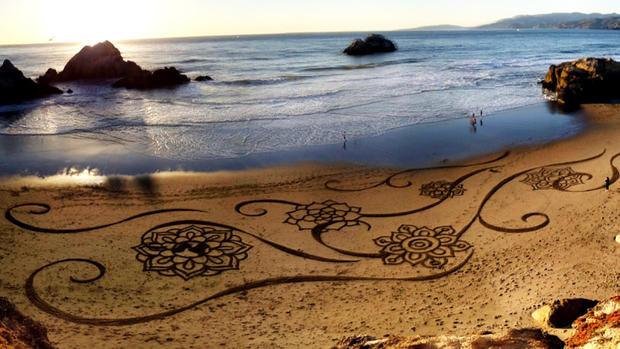 Sand artist uses beaches as his canvas