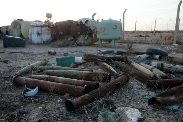 Discarded shells and cement-filled tanks litter the Al-Muthanna State Establishment, a Saddam Hussein-era chemical weapons manufacturing facility 40 miles northwest of Baghdad, after UN weapons inspectors entered the complex