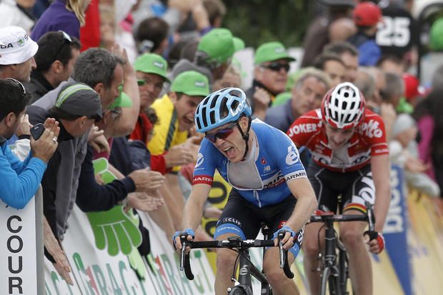 Garmin's Andrew Talansky of USA, winner of the 66th Dauphine cycling race, reacts as he crosses the finish line of the last stage