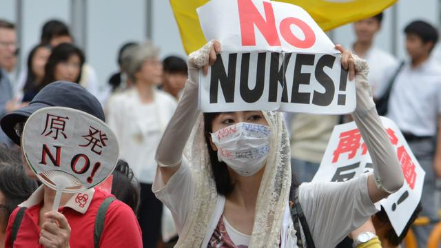 Protesters stage a demonstration march in Tokyo, June 28, 2014, against re-opening the Sendai nuclear power plant