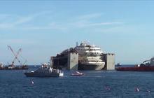 Costa Concordia heads to port