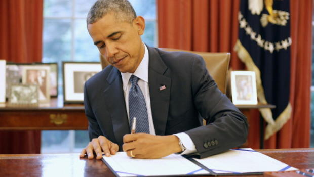 Image result for obama signing