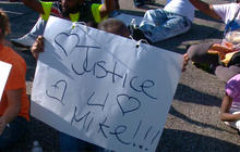 Ferguson officer identified as change in command lowers tension