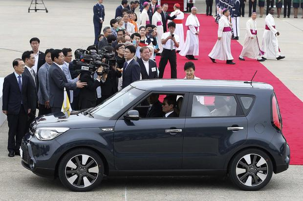 Pope Francis is seen in a Kia Soul car after his arrival at Seoul Air Base in Seongnam, South Korea
