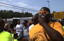 Following weeks of racial tension, Ferguson begins to calm down