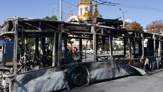 A burned trolleybus is seen near a Donetsk train station after shelling in Donetsk, Ukraine, Aug. 30, 2014.