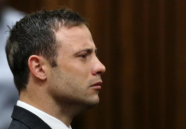 Olympic and Paralympic track star Oscar Pistorius listens to the verdict in his trial