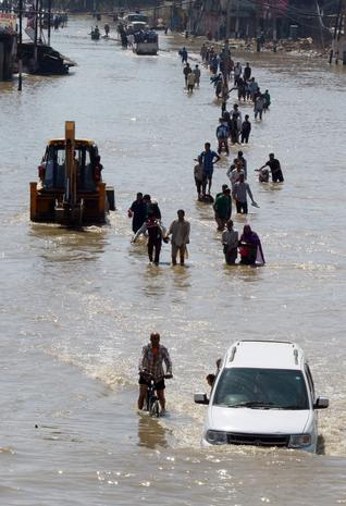 Flood of the century submerges India, Pakistan