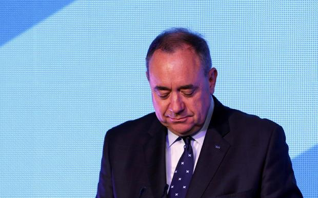 "Scotland's First Minister Alec Salmond reacts as he concedes defeat in the independence referendum at the ""Yes"" Campaign headquarters in Edinburgh"