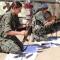 10-omar-omarfemale-fighters-clean-their-weapons.jpg