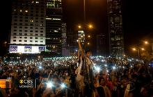 Protests grow amid celebrations in Hong Kong