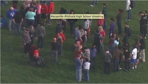school-shooting-students-in-field.png