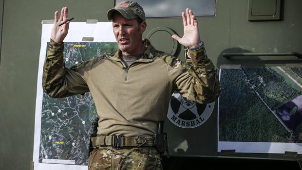 Scott Malkowski, a task force commander with the U.S. Marshals Service, Special Operations Group, gestures as he explains how Eric Matthew Frein reacted when he was captured while Malkowski talks with members of the media Oct. 31, 2014, in Cresco, Pennsyl