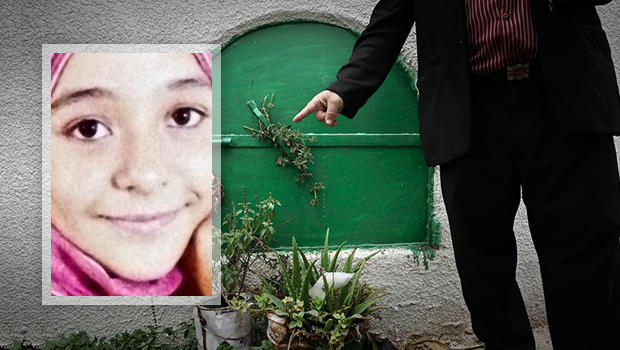 ​A man stands Nov. 5, 2014, in front of the grave of 13-year-old Suheir El-Batea, inset, who died undergoing the procedure of female genital mutilation performed by Dr. Raslan Fadl, in Dierb Biqtaris village, on the outskirts of the town of Aga in Dakahli