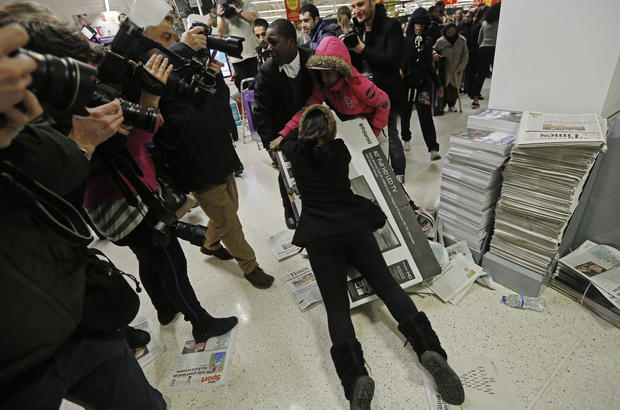 Black Friday crowds fill the stores