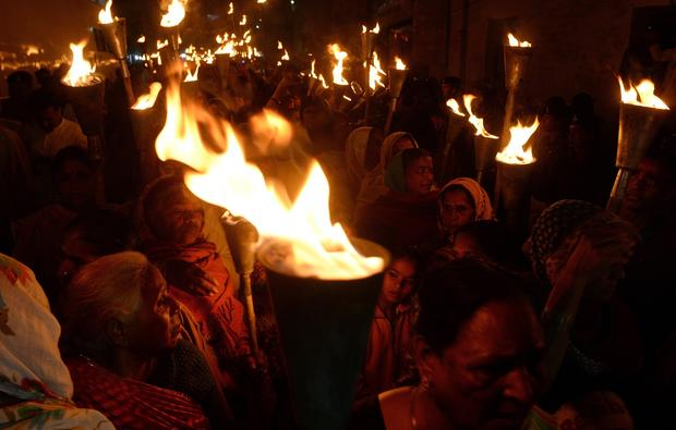 Indian victims and relatives of those killed in the Bhopal gas disaster take part in a torch-lit procession to mark the disaster's 30th anniversary in Bhopal Dec. 2, 2014.