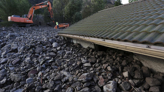 Rocks reach the roof of a home after a mudslide overtook several homes during heavy rains in Camarillo, California, Dec. 12, 2014.