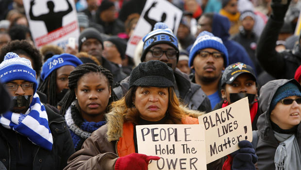 People gather for the start of the national Justice For All march, led by civil rights activist the Rev. Al Sharpton, against police violence in Washington Dec. 13, 2014.