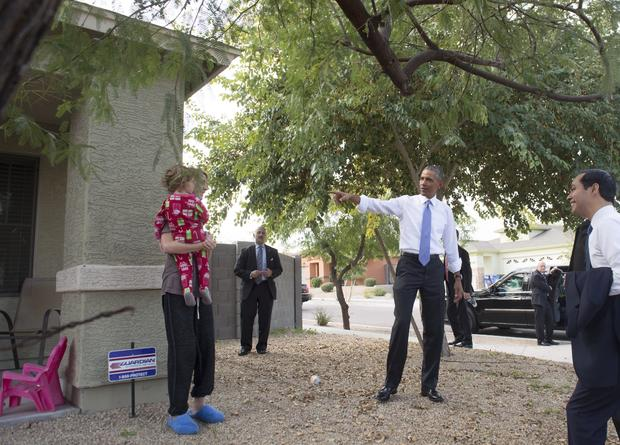 US President Barack Obama greets an area resident during a neighborhood stop to highlight his administration's home purchase and refinancing policies in Phoenix, Arizona, January 8, 2015.