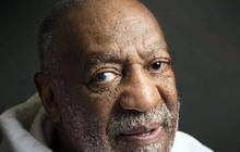 Cosby heckled during show, jokes about allegations