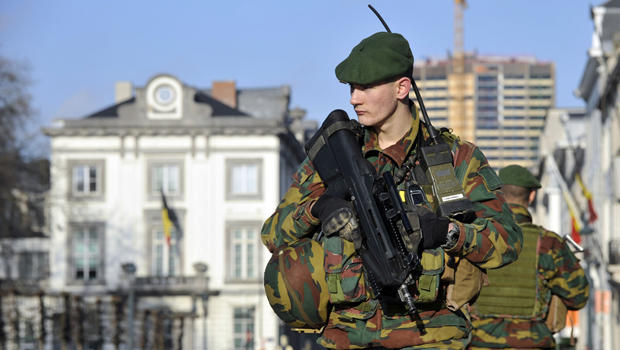 Belgian soldiers guard outside the U.S. Embassy in Brussels, near the Belgian Parliament, Jan. 17, 2015.