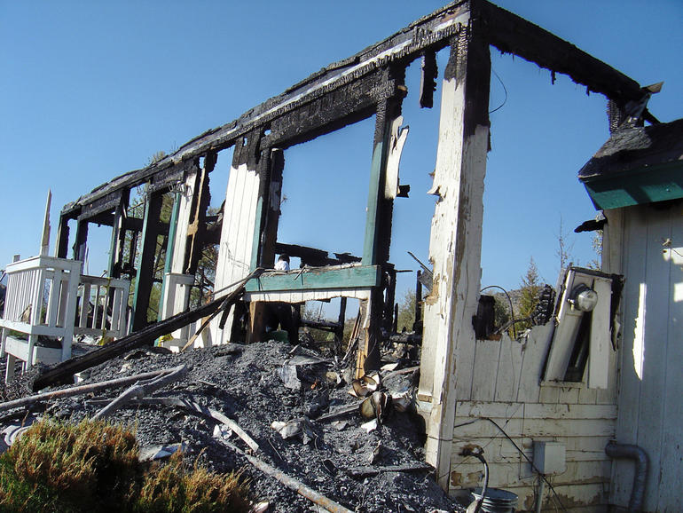 The burned remains of the home in Pinyon Pines, Calif.